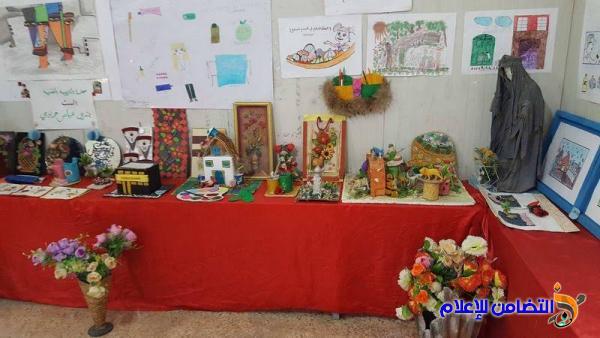 بالصور :: مدرسة التضامن الأولى للأيتام في الناصرية  تقيم معرضا للرسوم بالتعاون مع صحة ذي قار