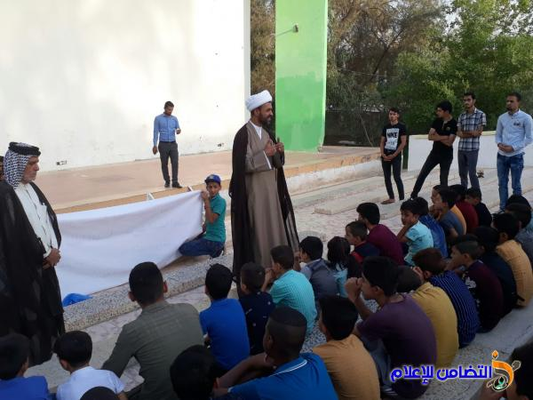 مدارس الإمام الصادق الصيفية تنظم وقفة تضامنية مع ضحايا الحادث الإرهابي في الناصرية -مصور-