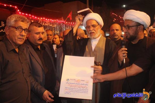 بالصور :موكب عـزاء جمعية التضامن الاسلامي يشارك بالمسيرة العاشورائية  في الليلة العاشرة وسط الناصرية