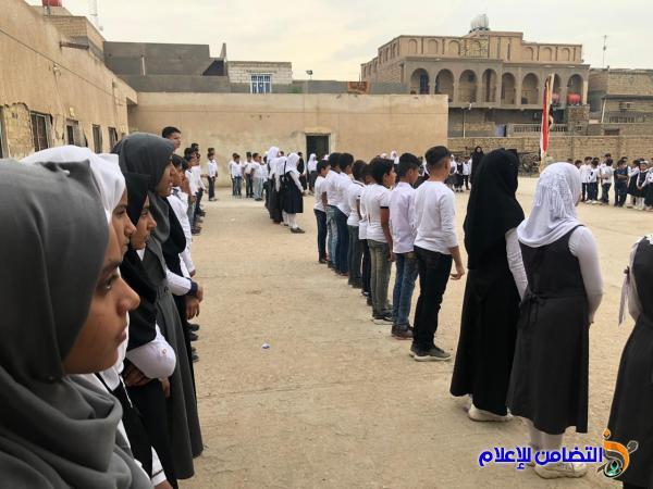 بالصور: مراسيم رفع العلم في مبرة التضامن السابعــة  للأيتام في قضاء الرفاعي بذي قار