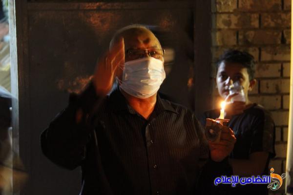 بالصور: جمعية التضامن الإسلامي تحيي ليلة الحادي عشر من المحرم بمسيرة من الشموع