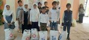 تواصل توزيع السلات الغذائية على مستحقيها في مبرات التضامن للأيتام في قضاء الجبايش والفهـود